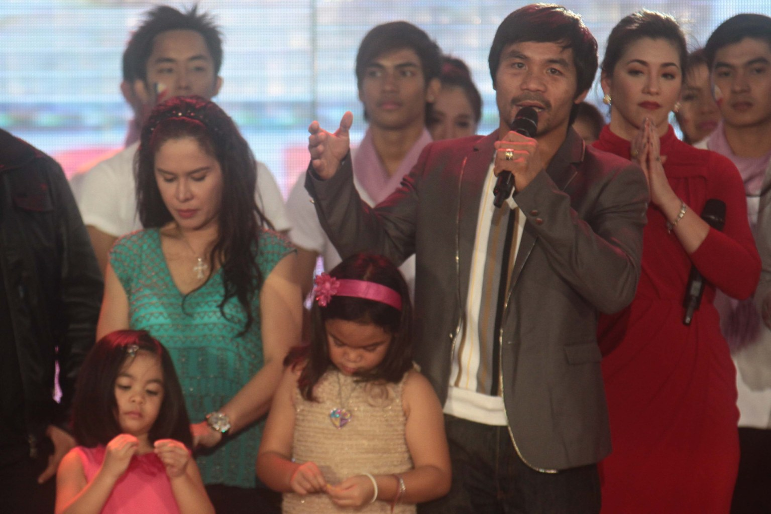 "Manny Pacquiao stands on stage with his wife Jinkee and kids Emmanuel Jr. ""Jimuel"", Michael, Princess and Queen Elizabeth and GMA talents. (George Calvelo/NPPA..."