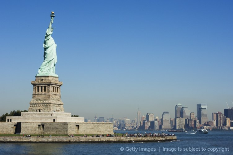 Statue of Liberty, Liberty Island and Manhattan skyline beyond, New York City, New York, United States of America, North America