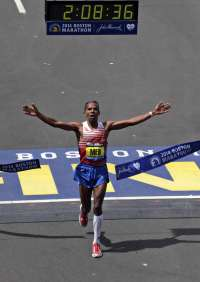 Meb Keflezighi, of San Diego, Calif., breaks the tape to win the 118th Boston Marathon Monday, April 21, 2014 in Boston